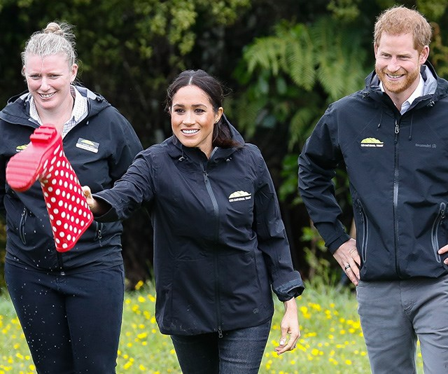 """2018 was filled with momentous events for Prince Harry and Meghan, and their mammoth 16-day royal tour of Australia, New Zealand, Fiji and Tonga was case in point.  <br><br> Chris was there to capture it all, and this candid image of the newly married royals in New Zealand playing a game of """"welly wanging"""" was a definite highlight. *(Image: Chris Jackson / Getty Images)*"""