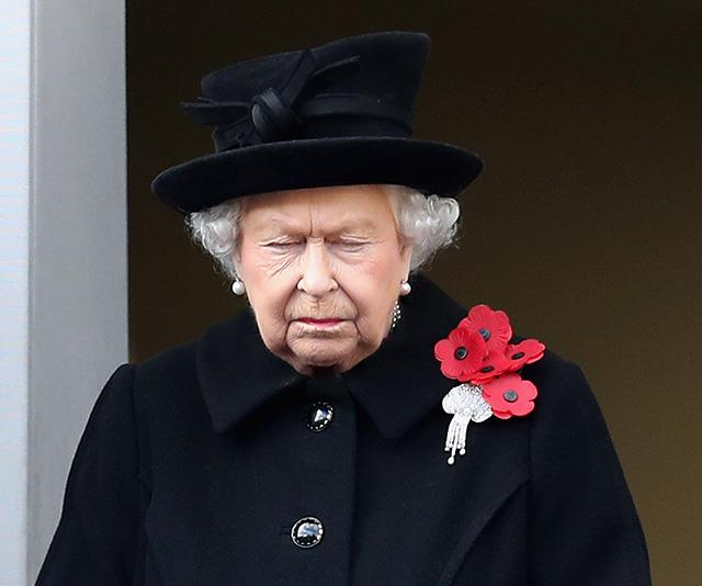 This striking image of the Queen on Remembrance Sunday in November was particularly poignant for Chris. Queen Elizabeth, dressed in the traditional mourning colour of black, was captured having a quiet moment during the sombre occasion. *(Image: Chris Jackson / Getty Images)*