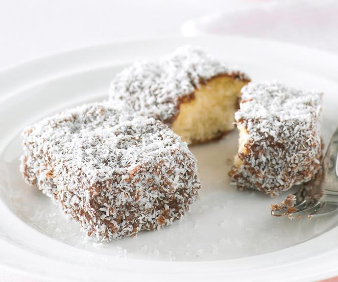 """**Gluten-free Lamingtons** <br><br> No childhood is complete without the taste of fresh lamingtons. Kids will love helping you make this recipes+ version of the Aussie staple, almost as much as they love licking the bowl! <br><br> See the full *Australian Women's Weekly* recipe [here.](https://www.womensweeklyfood.com.au/recipes/lamingtons-21899 target=""""_blank"""")"""