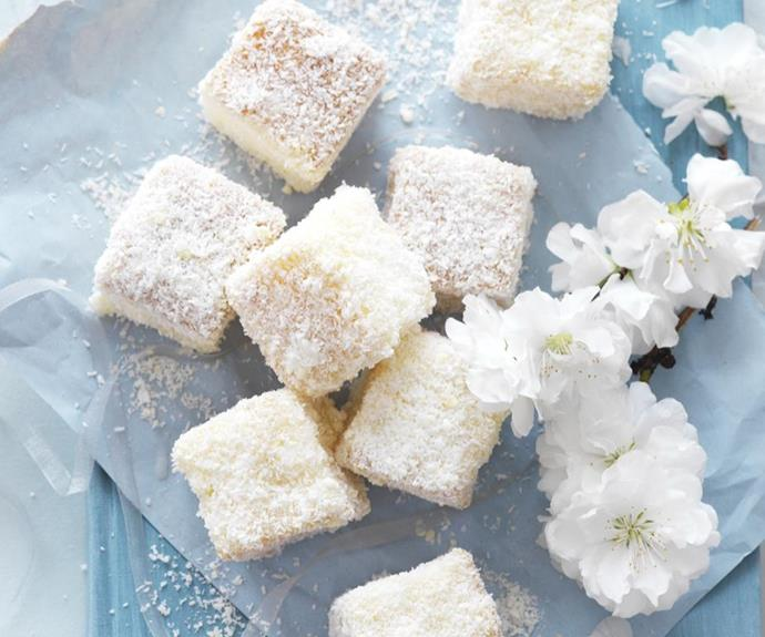 """**White chocolate lamingtons** <br><br> This recipe uses white chocolate instead of traditional milk chocolate, to give the lamingtons that pretty, snow-white effect.  <br><br> See the full *Australian Women's Weekly* recipe [here.](https://www.womensweeklyfood.com.au/recipes/white-chocolate-lamingtons-9411 target=""""_blank"""")"""