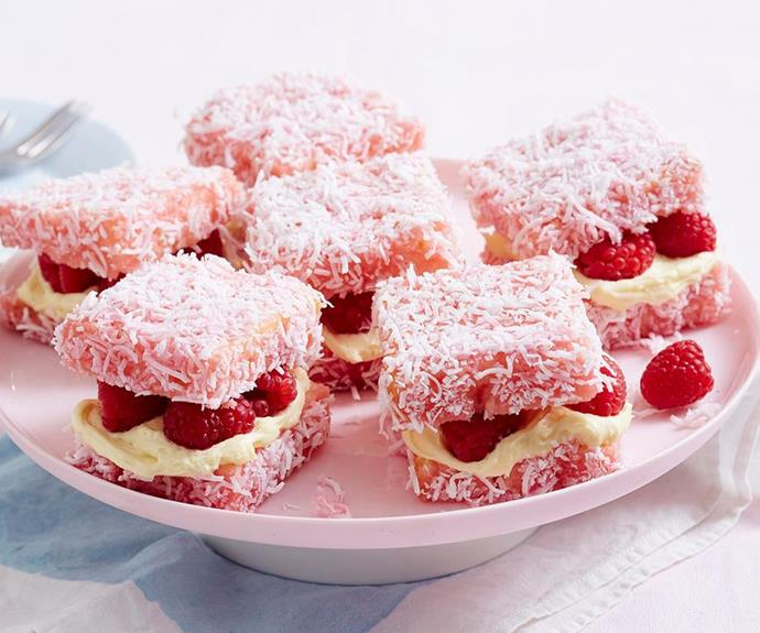 """**Raspberry cheesecake lamingtons** <br><br> These raspberry delights are a cute creative twist on your classic lamingtons! They're dipped in pink icing and layered with cream cheese filling and fresh raspberries for a fun treat everyone will love. <br><br> See the full *Australian Women's Weekly* recipe [here.](https://www.womensweeklyfood.com.au/recipes/raspberry-cheesecake-lamingtons-1975 target=""""_blank"""")"""