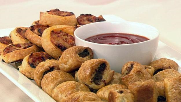 """**Sausage rolls and pizza spirals** <br><br> Delight both children and adults with these top-quality homemade sausage rolls and pizza spirals. <br><br> See the full *Australian Women's Weekly* recipe [here.](https://www.womensweeklyfood.com.au/recipes/sausage-rolls-and-pizza-spirals-7019