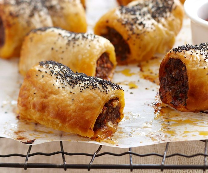 """**Spiced lamb sausage rolls** <br><br> Your guests will be reaching for more with this gourmet version of classic sausage rolls. Crunchy, golden pastry compliments the tender lamb filling just begging to be dipped in tomato sauce and gobbled up. <br><br> See the full *Australian Women's Weekly* recipe [here.](https://www.womensweeklyfood.com.au/recipes/spiced-lamb-sausage-rolls-27363