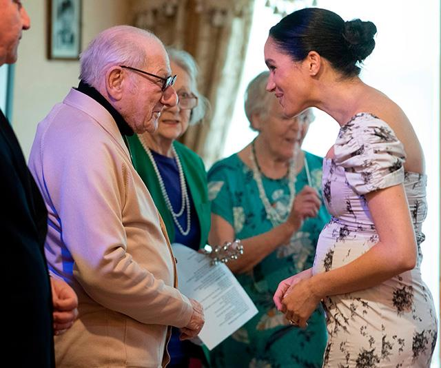 "Meghan [shared some sweet moments](https://www.nowtolove.com.au/royals/british-royal-family/meghan-markle-baby-bump-floral-53199|target=""_blank"") with residents at the nursing home during the visit, even telling one that she was feeling ""very pregnant"" that day! *(Image: Getty Images)*"