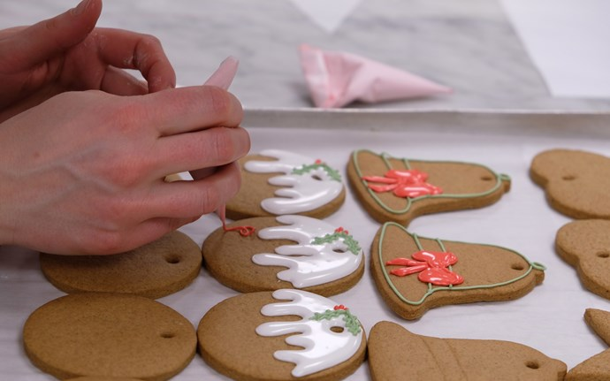 Use a piping bag to draw on the icing. *(Image: Buckingham Palace)*