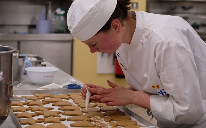 One of the royal chefs at work in the kitchen. *(Image: Buckingham Palace)*