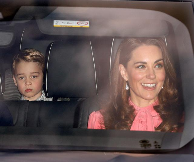 That face! George looked slightly bemused as the famous family were snapped entering Buckingham Palace. *(Image: Getty)*