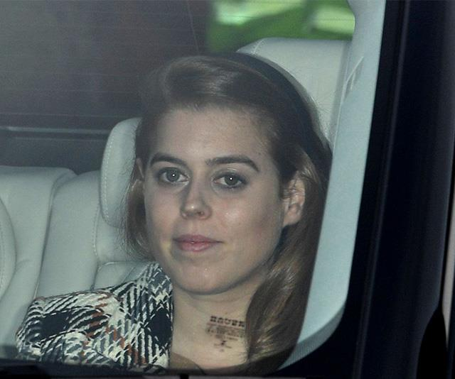 Beatrice wore her red hair styled back in a headband with a tartan printed coat. *(Image: Rex)*
