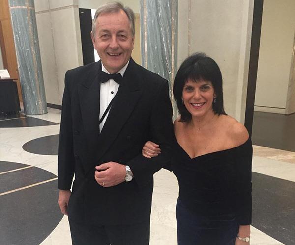 Julia and her husband Mike at the Mid Winter Ball. *(Image: Instagram @juliabankschisholm)*