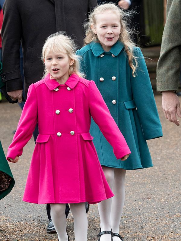 Pretty in pink...and turquoise! Savannah Phillips walks behind her little sister Isla. *(Image: Getty Images)*