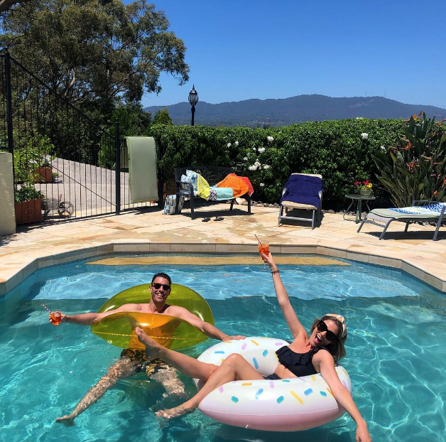 *Bachelorette* lovebirds Georgia Love and Lee Elliott looked super chilled out as they floated in the pool. *(Image: Instagram @georgiealove)*
