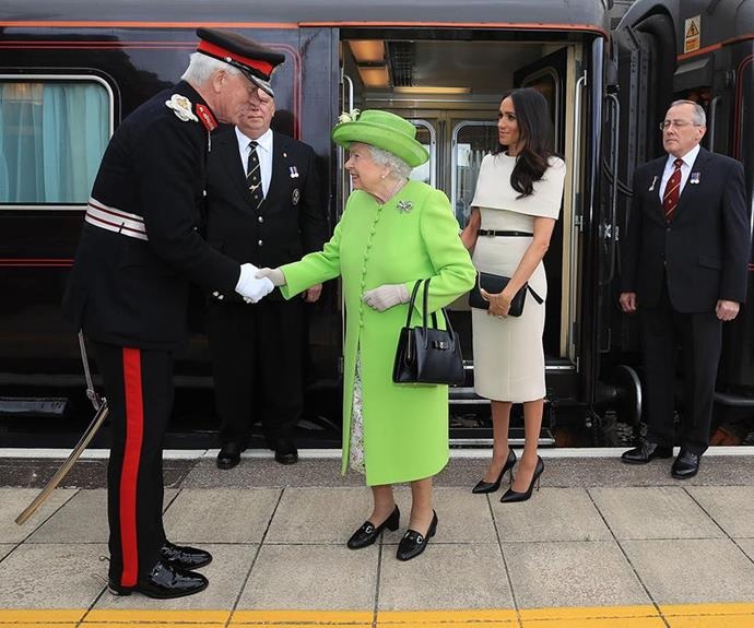 And Meghan was given the proper royal treatment, riding the Queen's private train to the event. *(Image: Getty)*