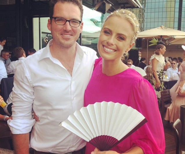 Subtle fan-placement at 2018's Melbourne Cup had fans wondering if there was something the couple weren't telling them. *(Image: Instagram/Sylvia Jeffreys.)*