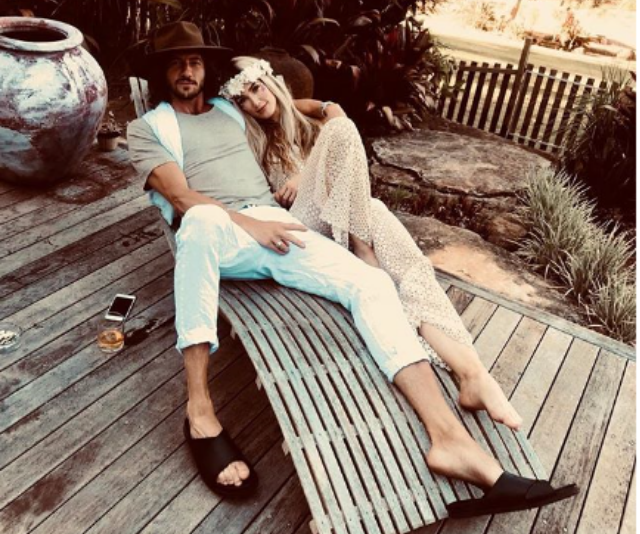 A rare PDA from the private couple. *(Image: Instagram @deltagoodrem)*