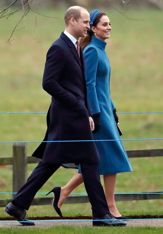 Kate and Wills smiled at onlookers as they walked through Sandringham. *(Image: Getty)*
