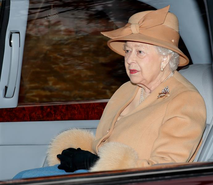 Queen Elizabeth also donned a wintry ensemble as she attended the church service. *(Image: Getty)*