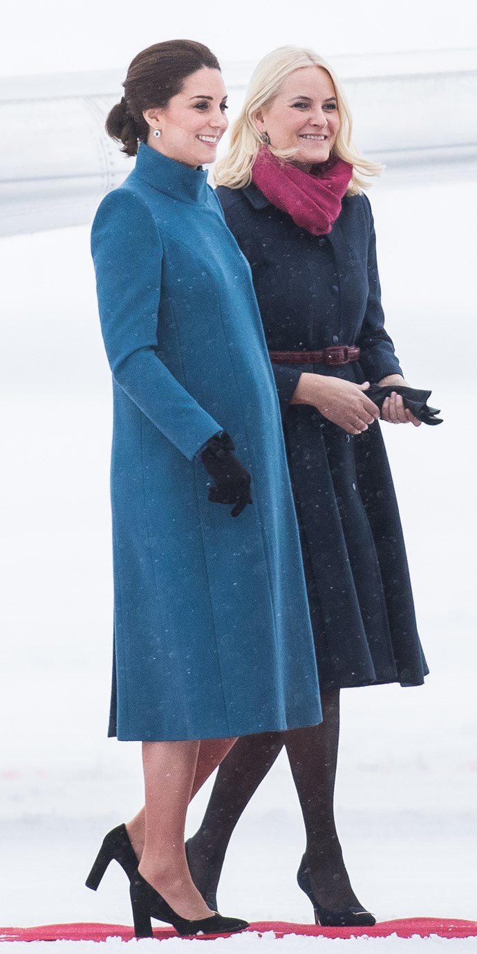 The then-pregnant Kate looked equally as stunning when she wore the same blue coat during a trip to Norway at the start of 2018. *(Image: Getty)*