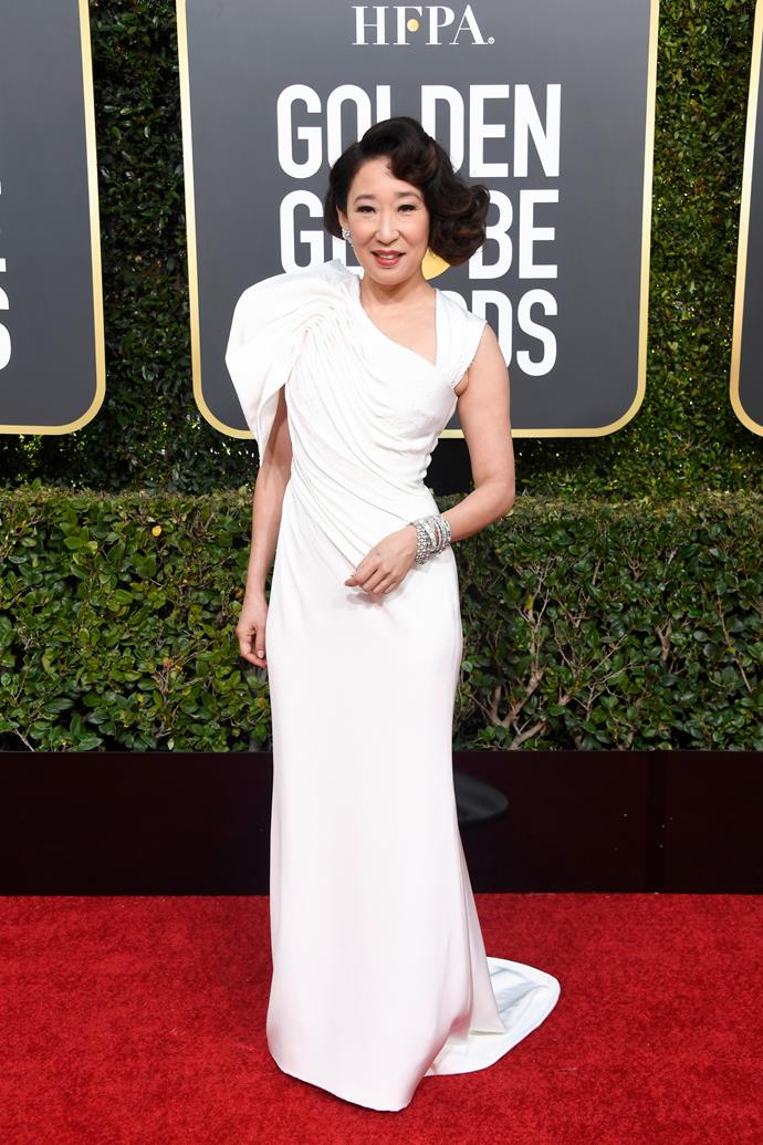 *Golden Globe's* host and *Killing Eve* actress, Sandra Oh, looks stunning in white on the red carpet.