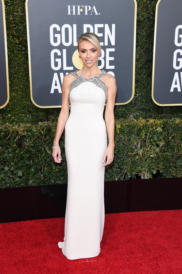 E! star Giuliana Rancic's angelic look was topped with a silver trimming alongside the gown's halter neckline and straps.