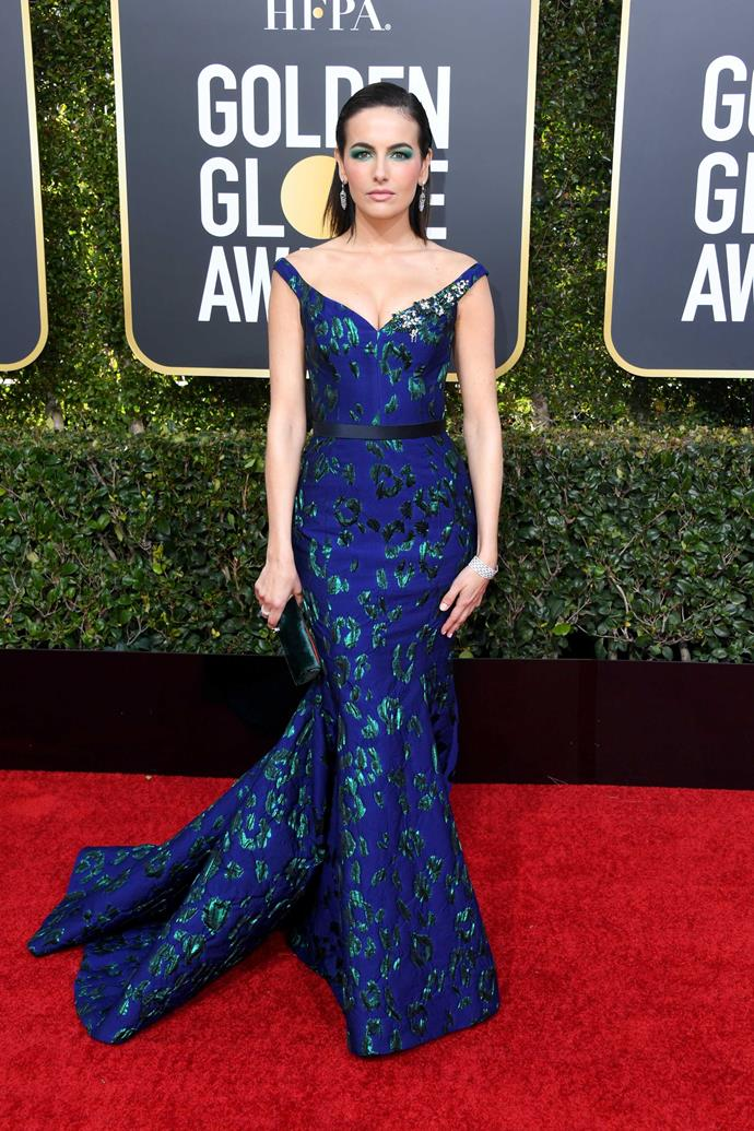 Actress Camilla Belle is bringing the mermaid look back in jewel tones - emerald green and sapphire blue.