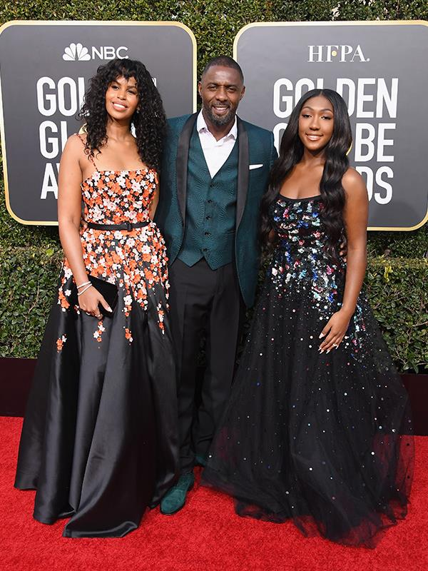 British actor, Idris Elba, surrounded by beauty - his wife Sabrina Dhowre and daughter - Miss Golden Globes, Isan Elba.
