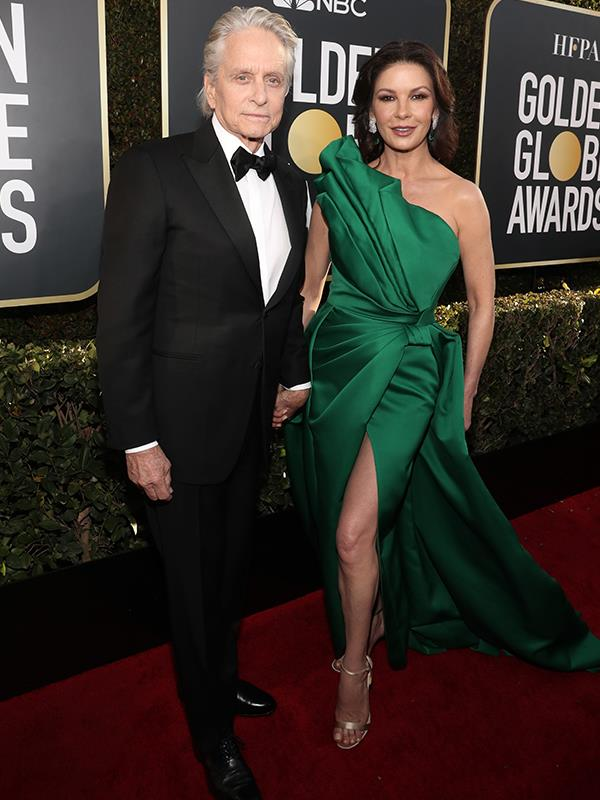 A royal couple in emerald green, Michael Douglas and his Queen, Catherine Zeta-Jones arrive at the Golden Globes.