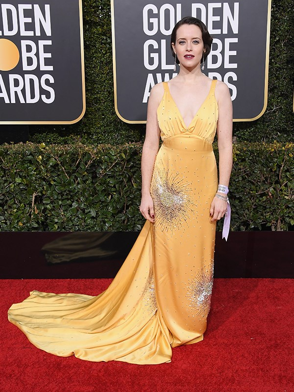 "*The Crown's* [Claire Foy](https://www.nowtolove.co.nz/lifestyle/career/claire-foy-juggling-motherhood-and-playing-steely-women-39781|target=""_blank"") channelled old school 1920s glamour in this mustard yellow dress, but sadly for her it's not the most flattering look."