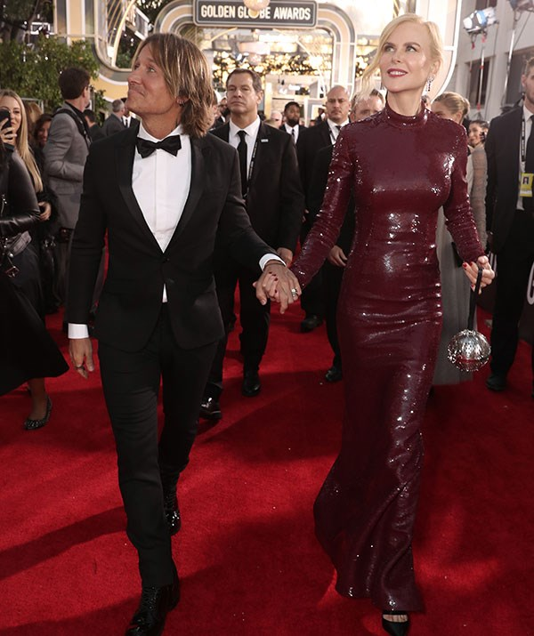 Bringing her good luck charm! Nicole and Keith dazzle on the 2019 Golden Globes red carpet.