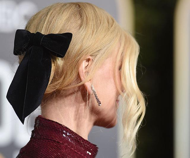 A chic twist: Nicole's locks were swept up in a velvet black bow.