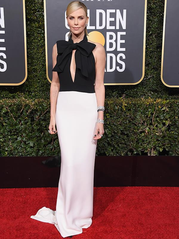 All Charlize Theron's black-and-white *Bond* girl look needs is a martini, shaken, not stirred.