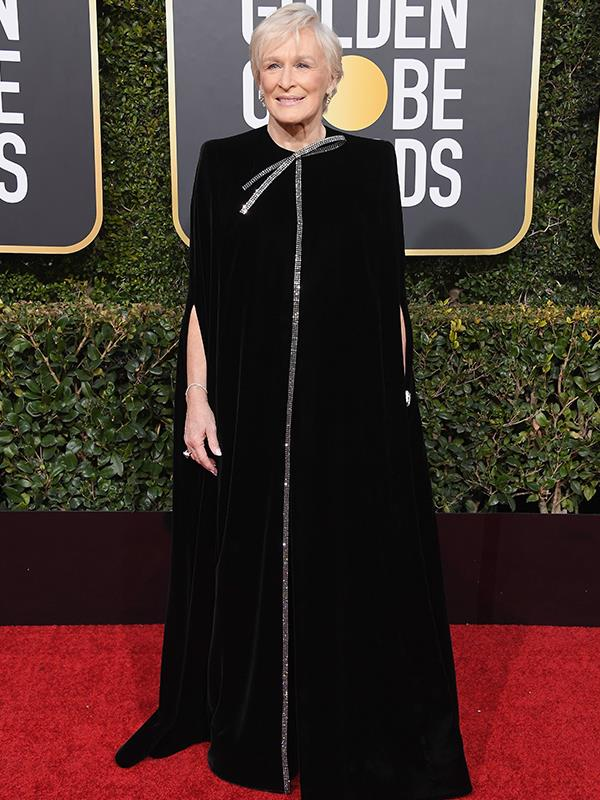 Best Actress winner Glenn Close rocks this fierce black caped ensemble.