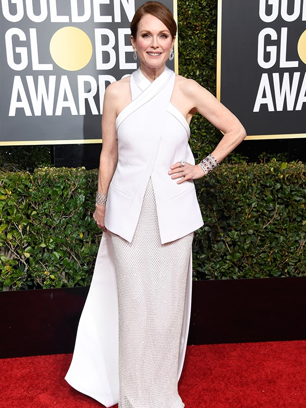 Julianne Moore opted for a structured, high-neck white frock.