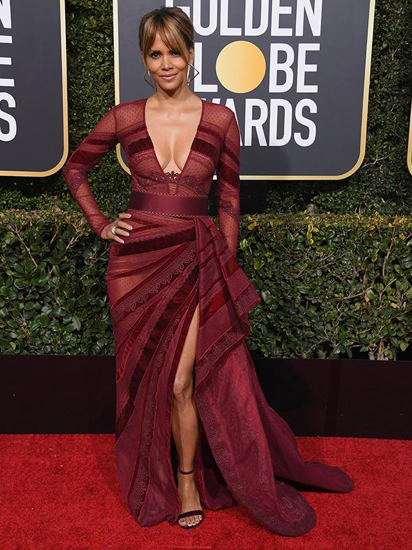 "Berry by name, berry by colour! Halle Berry's s jaw-dropping maroon-coloured gown accentuates her toned figure. [**READ NEXT: Celebrity faces frozen in time at the 2019 Golden Globe Awards**](https://www.nowtolove.com.au/beauty/ageing/golden-globes-plastic-surgery-53358|target=""_blank"")"