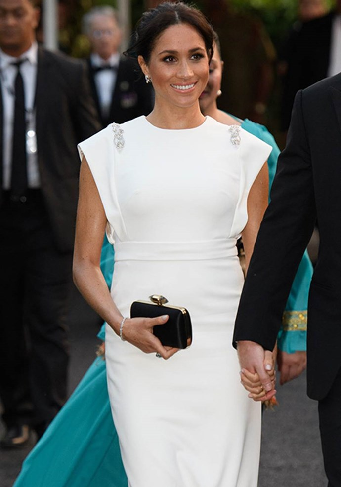 Meghan wore a stunning tennis bracelet gifted to her by Prince Charles alongside Princess Diana's stunning aquamarine ring. *(Image: Getty)*