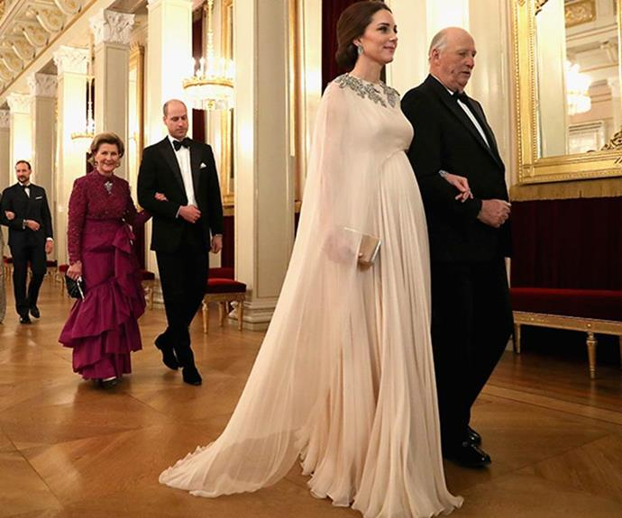 **Resplendently regal:** Kate looked heavenly in this Alexander McQueen number worn during a glamorous dinner at the Royal Palace in Oslo with their Norwegian counterparts in February 2018. (Image: Getty)