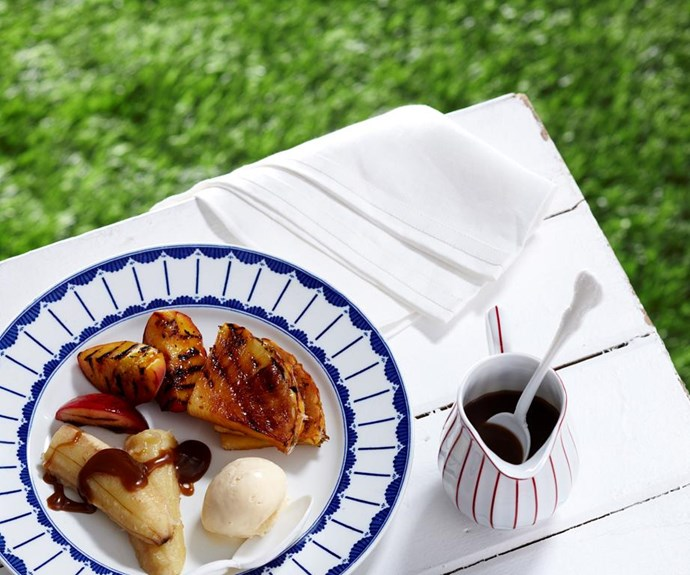"""**Barbecued tropical fruit with rum sauce** <br><br> Beautiful tropical summer fruit is caramelised on the grill and is perfect served drizzled with a sweet coconut rum sauce and a scoop of vanilla ice-cream. <br><br> See the full *Australian Women's Weekly* recipe [here](https://www.womensweeklyfood.com.au/recipes/barbecued-tropical-fruit-with-rum-sauce-28410