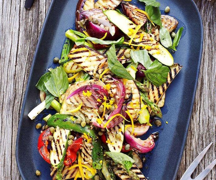 """**Barbecued vegetable salad** <br><br> Tossed in a fragrant marinade, this glorious barbecued vegetable salad is packed full of char-grilled eggplant, zucchini, asparagus and onions to create a brilliant side dish, perfect to go alongside roasted meat. <br><br> See the full *Australian Women's Weekly* recipe [here](https://www.womensweeklyfood.com.au/recipes/barbecued-vegetable-salad-27469