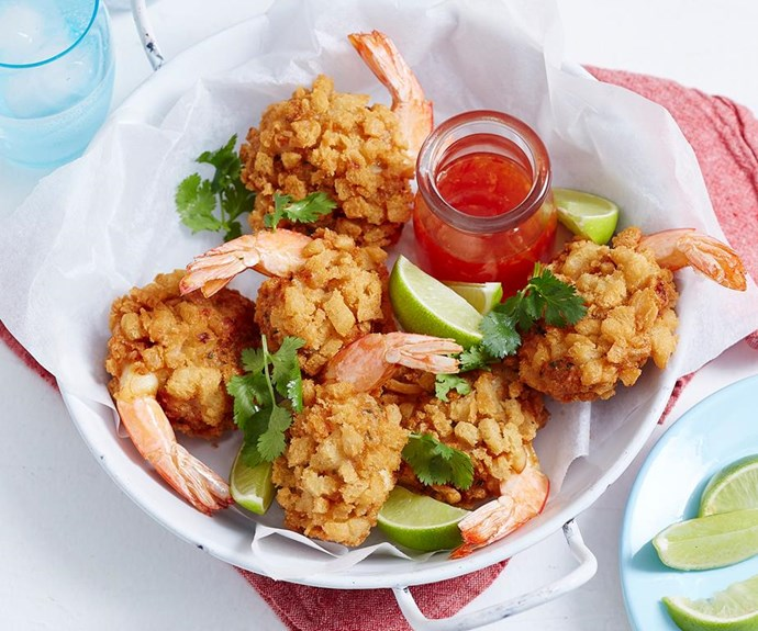 """**Crispy prawn balls** <br><br> Coated in a crispy bread and chive batter, these deep-fried beauties are the perfect way to kick off any summer menu. Serve with sweet chilli sauce and lime for the ultimate flavour explosion. <br><br> See the full *Australian Women's Weekly* recipe [here](https://www.womensweeklyfood.com.au/recipes/crispy-prawn-balls-1891