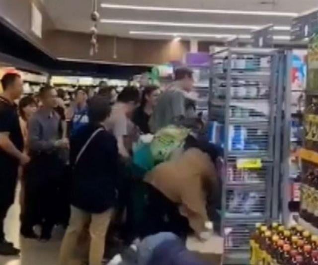 Customers were thrown to the floor in violent scenes this week. *(Image: Nine News.)*