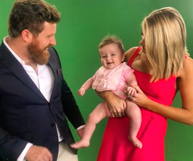 Doting mum, Erin takes little Eliza into visit Triple M in Brisbane. *Image: Instagram/Erin Molan*
