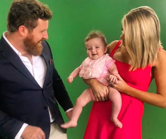 Doting mum, Erin takes little Eliza into visit Triple M in Brisbane. *Image: Instagram/Erin Molan*
