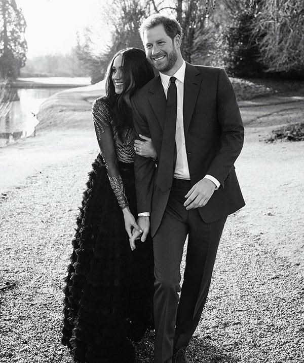 A newly engaged Meghan and Harry strolling around the grounds of Frogmore House last December. *(Image: Alexi Lubomirski)*