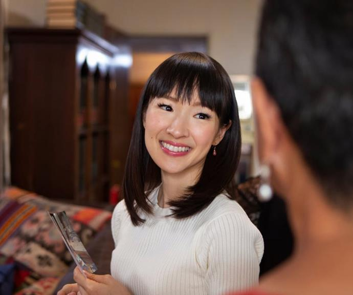 She might look sweet and cute, but Kondo is on a serious mission to help us get rid of our excess stuff. *(Image: Getty)*