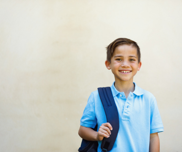 Choosing the right bag for your child can reap big benefits for their spinal health. *(Image: Getty images.)*