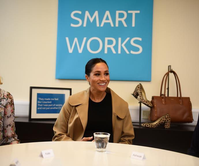 Duchess Meghan chats with SmartWorks staff members. *(Source: Getty)*
