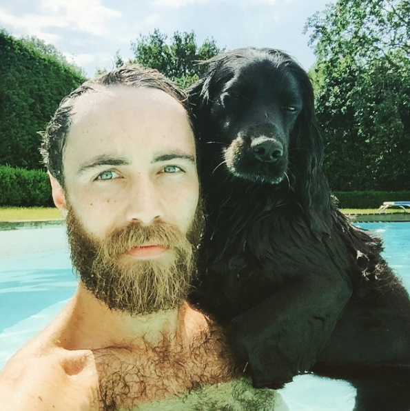 James and pup both successfully pulling off the 'blue steel'. *(Image: Instagram /  @jmidy)*