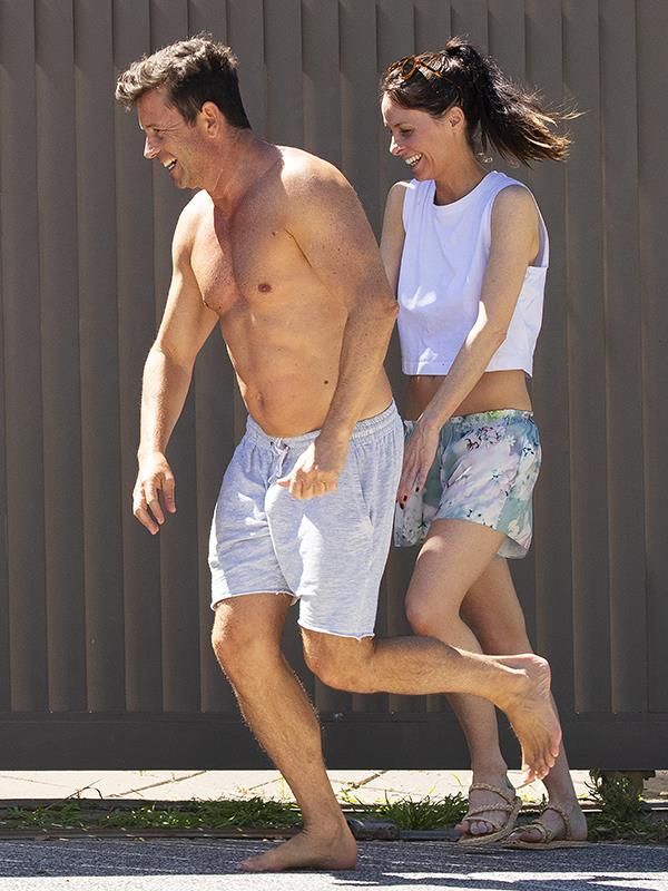 After hitting the shops, the happy pair headed for the beach. *(Image exclusive to Matrix)*