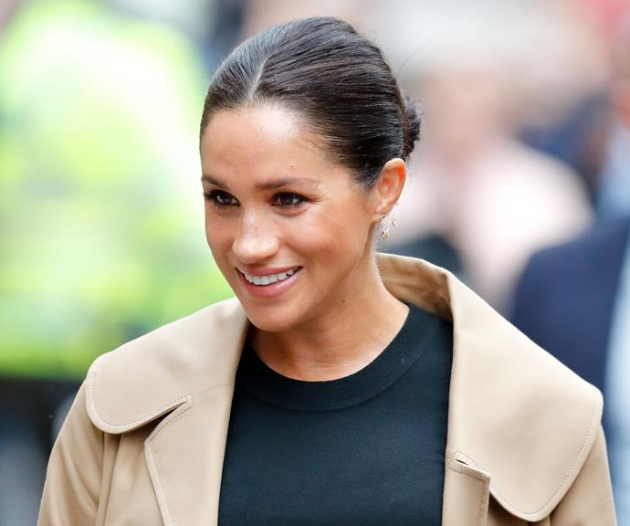 Meghan is fast becoming a pro at perfecting the bun! *(Image: Getty)*