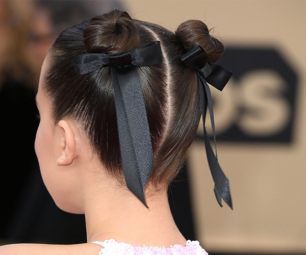 Double up and add some ribbons like Millie Bobby Brown. *(Image: Getty Images)*