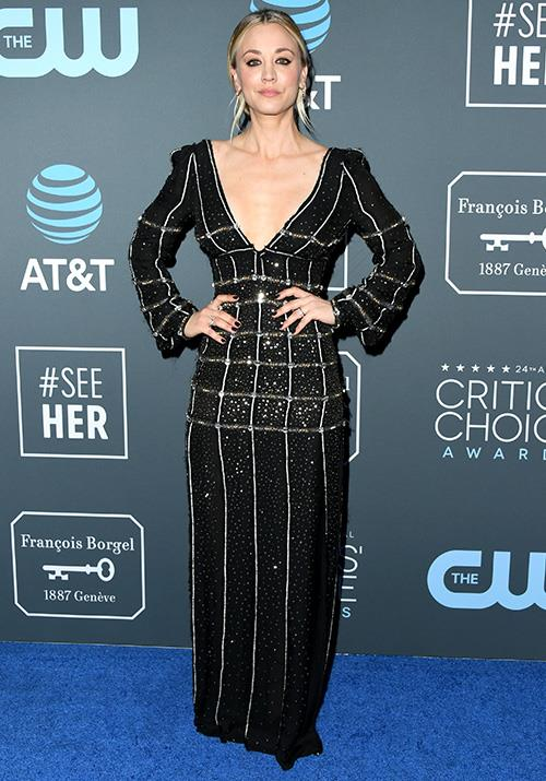 Kaley Cuoco's figure hugging dress with a plunging neckline was a head turner! *(Image: Getty)*